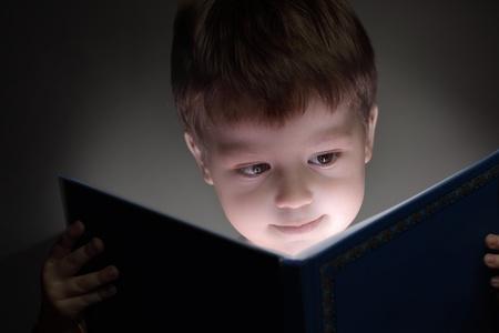 little boy reading a book photo