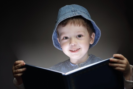 little boy reading a book photo