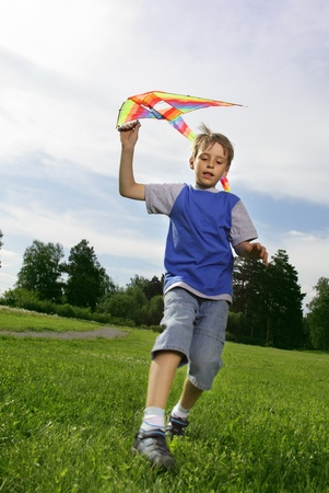 happy boy with a kite in his hand photo