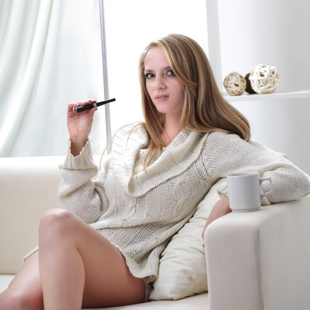 beauty girl indoors, holding a bottle of eye mascara photo