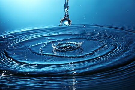 blue water ripple: water drops creating a ripple effect