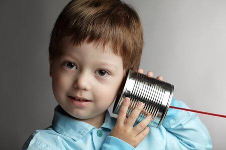 telecommunication equipment: beauty boy listen tin can telephone