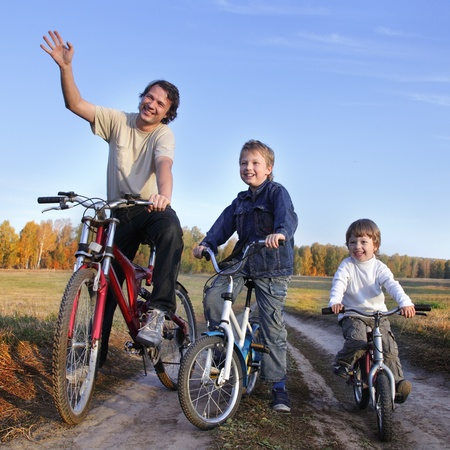 family fun day:  family on bike