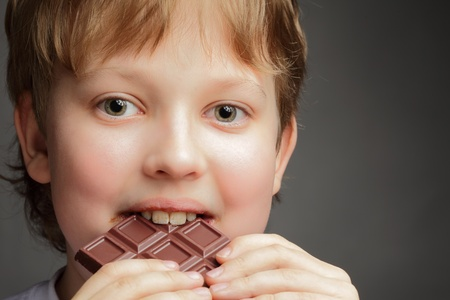 happy boy with chocolate bar photo