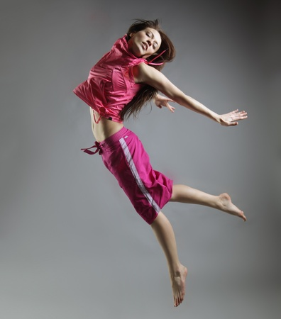 beauty girl dance on grey background photo