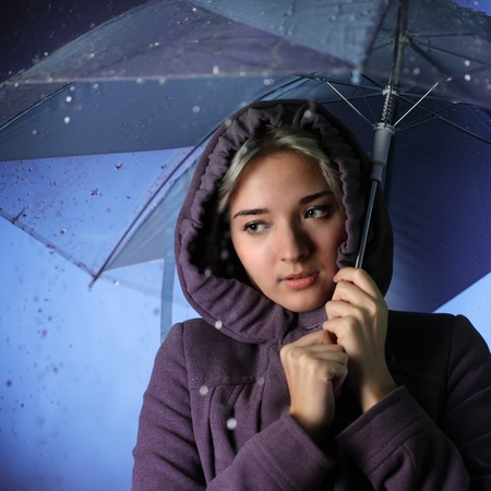 frozen girl in the rain Stock Photo - 12413525