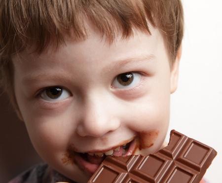 chocolate slice: happy boy with chocolate bar