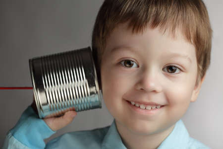 beauty boy listen tin can telephone Stock Photo - 12601338