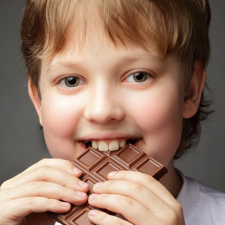 happy boy with chocolate bar photo