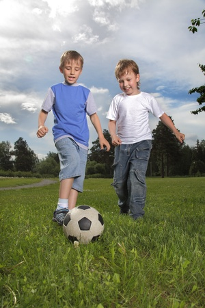 two happy boy play in soccer Stock Photo - 12601367