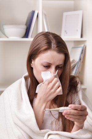 suffers: she suffers a cold Stock Photo