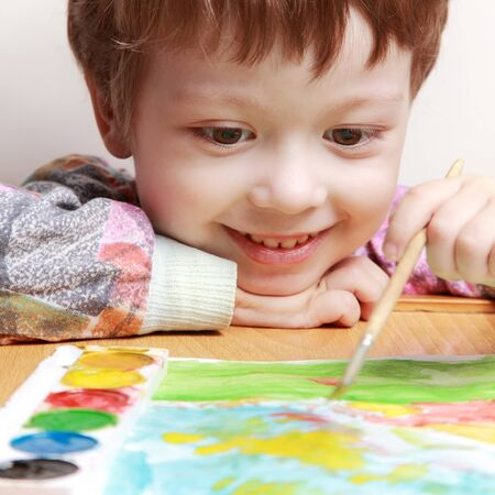 happy children draw picture  photo