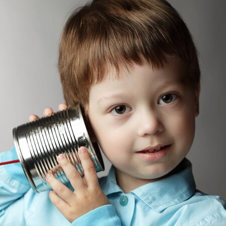 beauty boy listen tin can telephone Stock Photo - 12601695