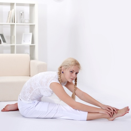 beauty girl stretching  muscles Stock Photo - 12601652