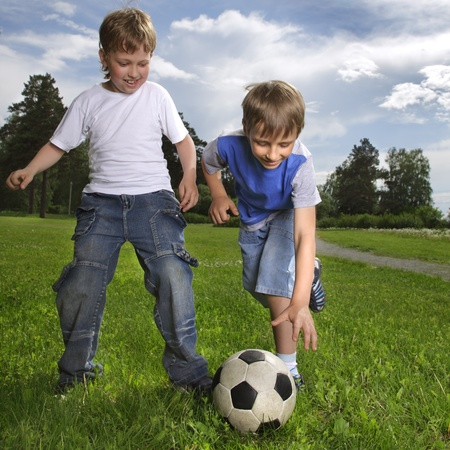 1 boy only: two happy boy play in soccer
