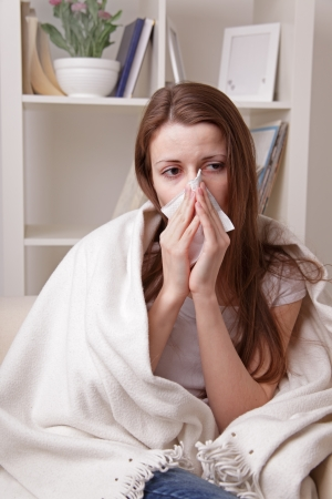 flu shot: she suffers a cold Stock Photo