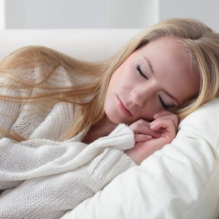 beauty girl slip on sofa photo
