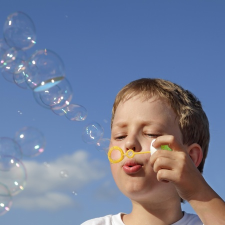 boy play in  bubbles photo