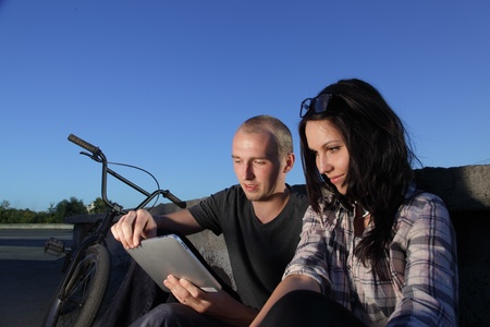 beauty couple with tablet PC  photo