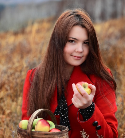 beauty girl with apple outdoors Stock Photo