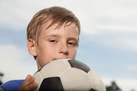 kids football: boy with soccer ball