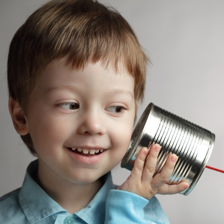 beauty boy listen tin can telephone Stock Photo - 13117322