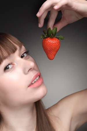 beauty girl eating strawberries photo