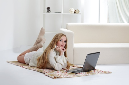 beauty girl with laptop in room photo