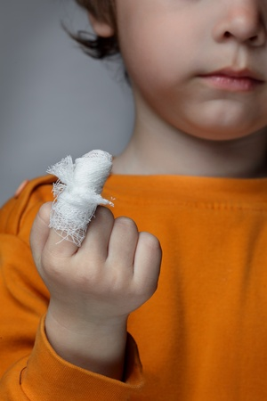 physical injury: boy with a wound on his finger Stock Photo