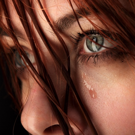 adult crying: beauty girl cry on black background