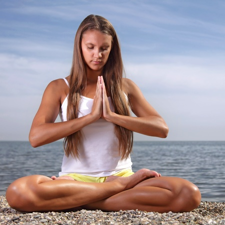 beauty girl in lotus pose photo