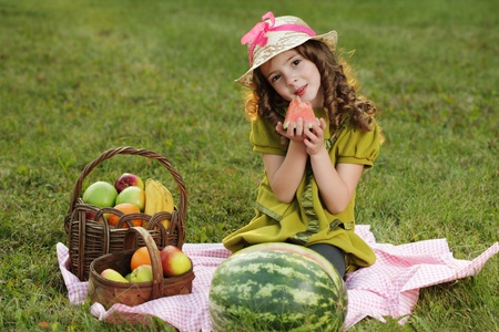 girl with fruit in park Stock Photo - 13553777