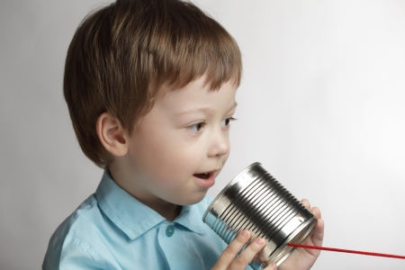 beauty boy speak in tin can telephone Stock Photo - 13606777