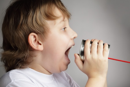 beauty boy speak in tin can telephone Stock Photo - 13606793
