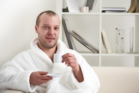 young man with coffee cup photo