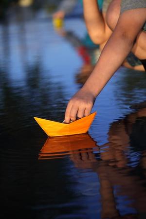 paper ship in children hand Stock Photo