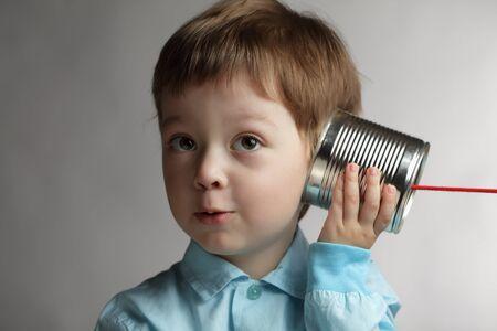 children talking: beauty boy listen tin can telephone