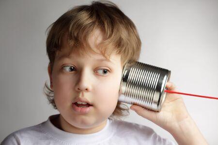 beauty boy listen tin can telephone Stock Photo - 13899997
