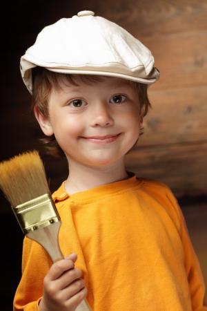 happy boy with paint brush photo