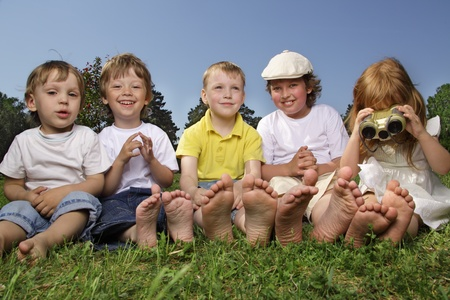 happy children on grass outdoors photo