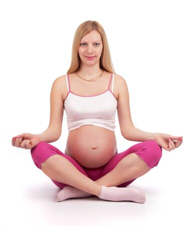 pregnancy yoga: beauty pregnancy girl in lotus pose
