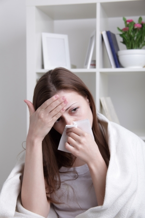 she suffers a cold Stock Photo