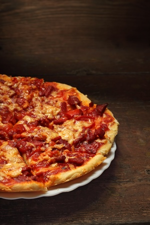 round pizza on wood background Stock Photo - 14039681