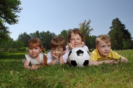 youth sports: Happy boys with soccer ball  Stock Photo
