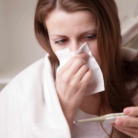 flu shots: she suffers a cold Stock Photo