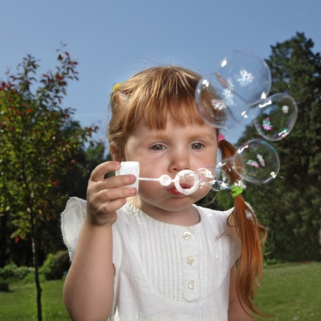 girl play in  bubbles photo