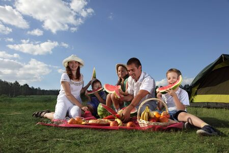families picnic outdoors with food photo