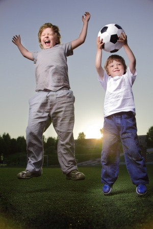 two happy boy play in soccer Stock Photo - 14446728