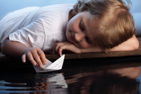 paper boat: paper ship in children hand Stock Photo