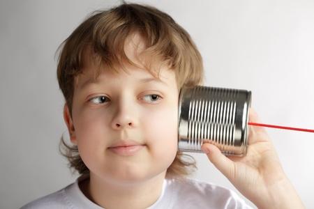 beauty boy listen tin can telephone Stock Photo - 14446762